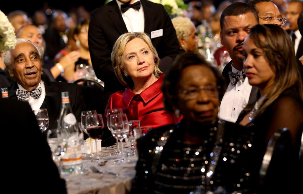 Image: Democratic presidential candidate Hillary Clinton listens to a speaker
