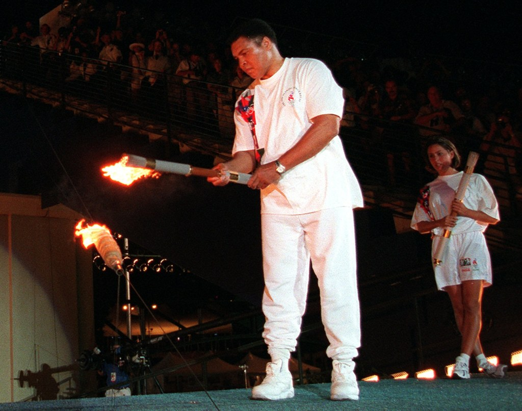 Image: Muhammad Ali lights the Olympic flame in Atlanta on July 19, 1996