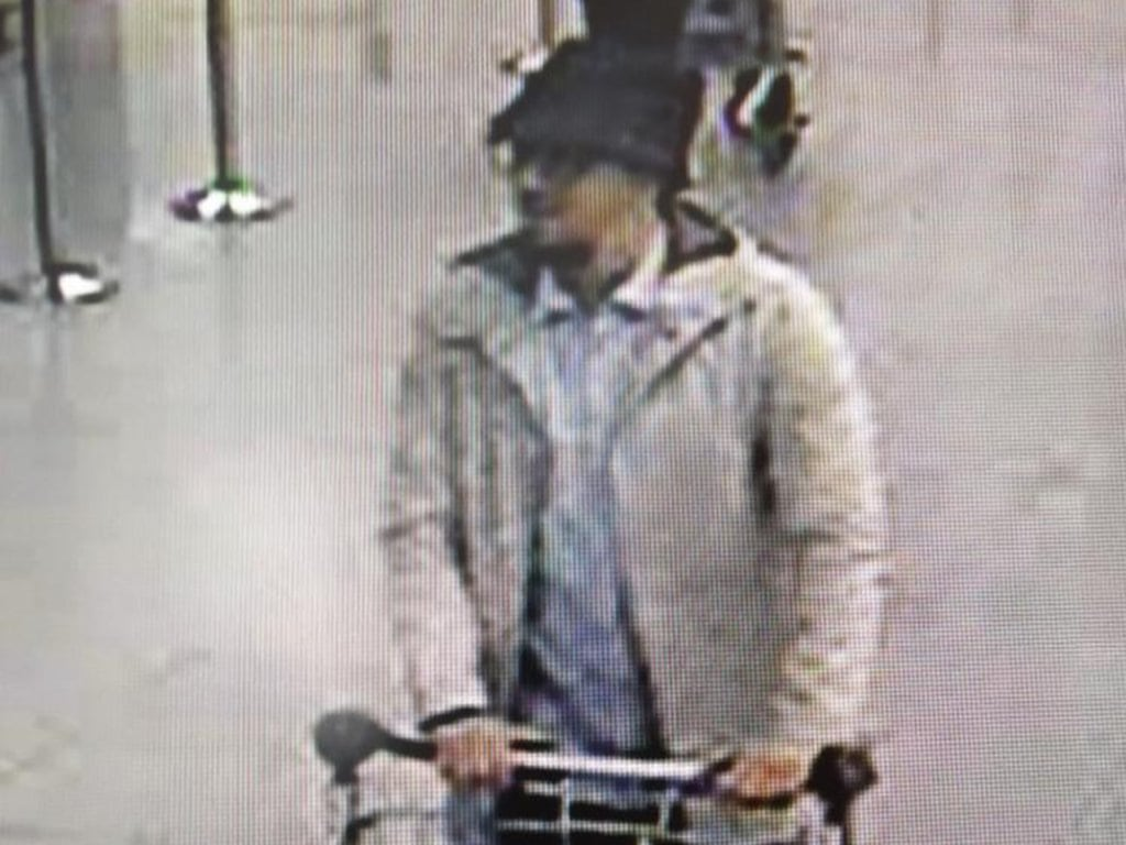 Image: A handout image released on March 22, 2016 by the Belgian Federal Police shows a screen grab of the airport CCTV camera showing a suspect