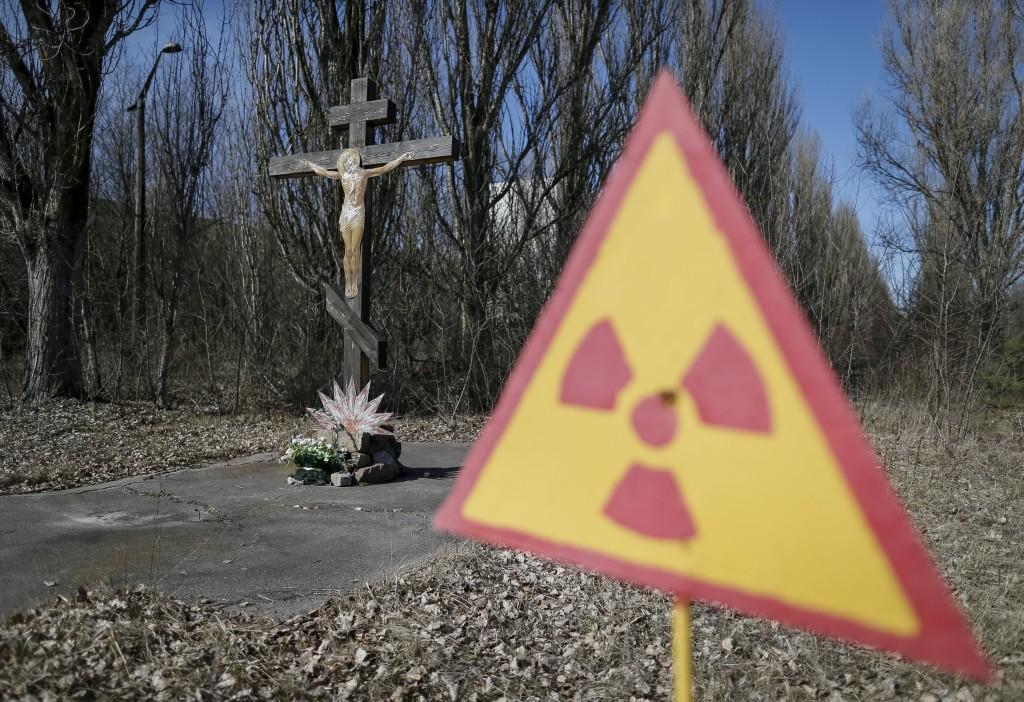 Image: A cross with a crucifix is seen in the deserted town of Pripyat near Chernobyl Nuclear Power Plant in Ukraine