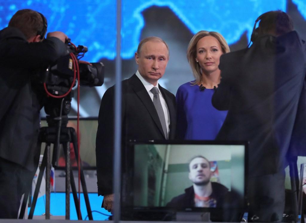 Image: Russian President Putin talks to journalists