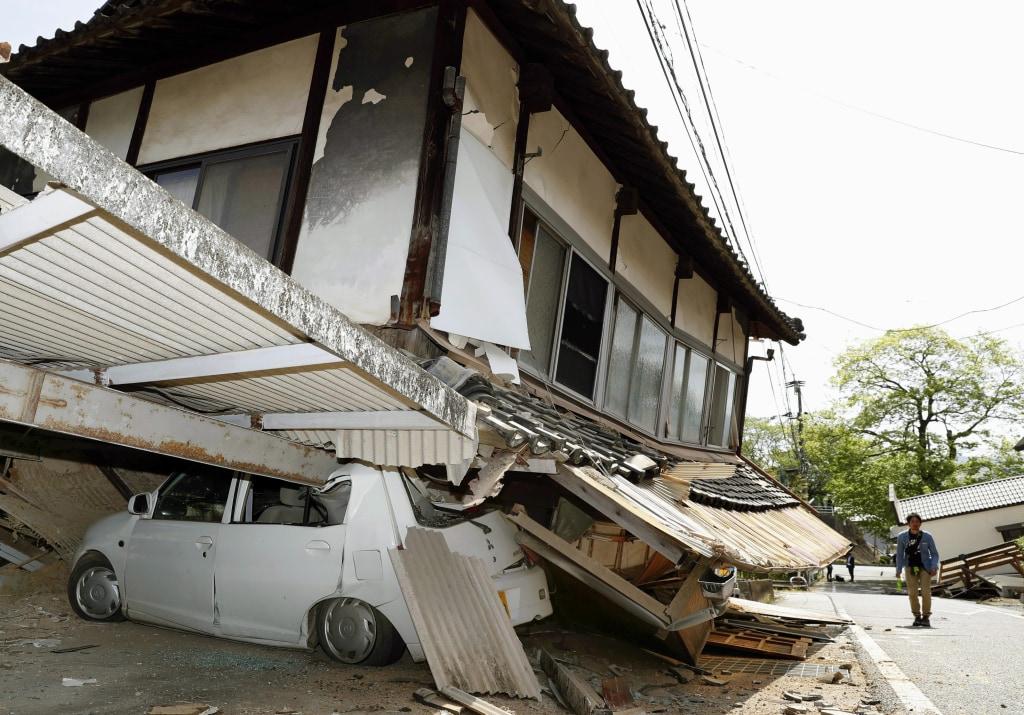 Image: A crushed car