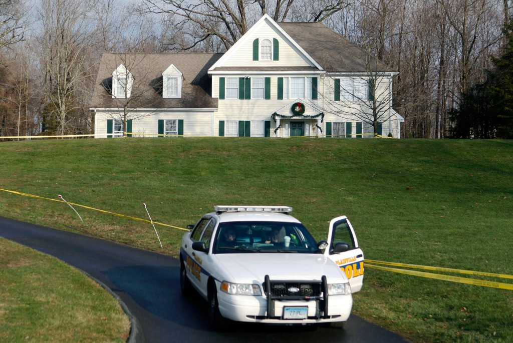 Image: A police cruiser sits in the driveway of the home of Nancy Lanza