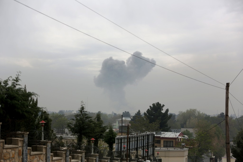Image: Smoke rises after a suicide attack in Kabul