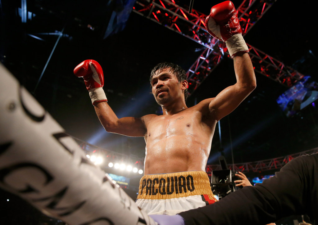 Image: Manny Pacquiao celebrates after winning in Las Vegas, Nevada