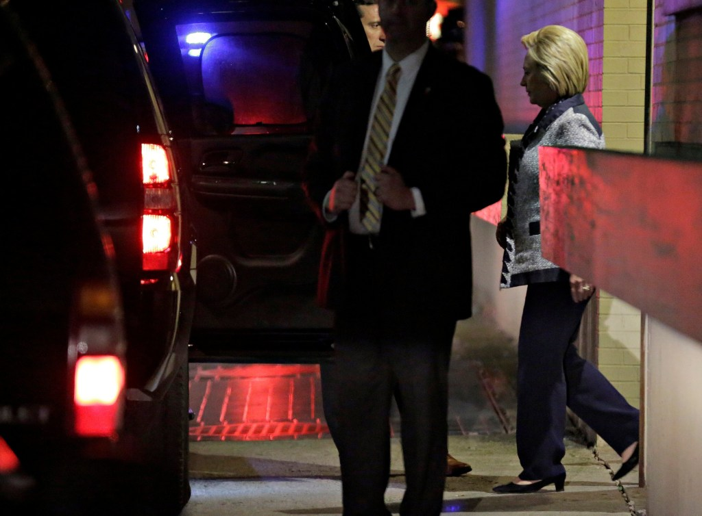 Image: Hillary Clinton departs after meeting Bernie Sanders