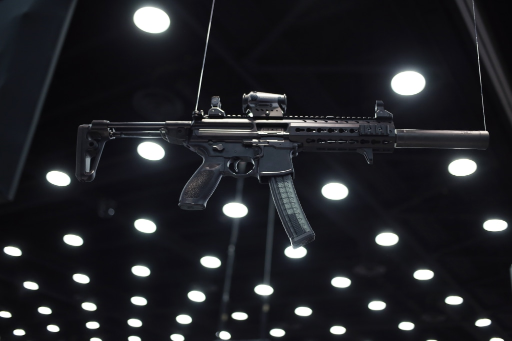 Image: A SIG MPX hangs from the ceiling at the SIG Sauer GmbH on the exhibit floor