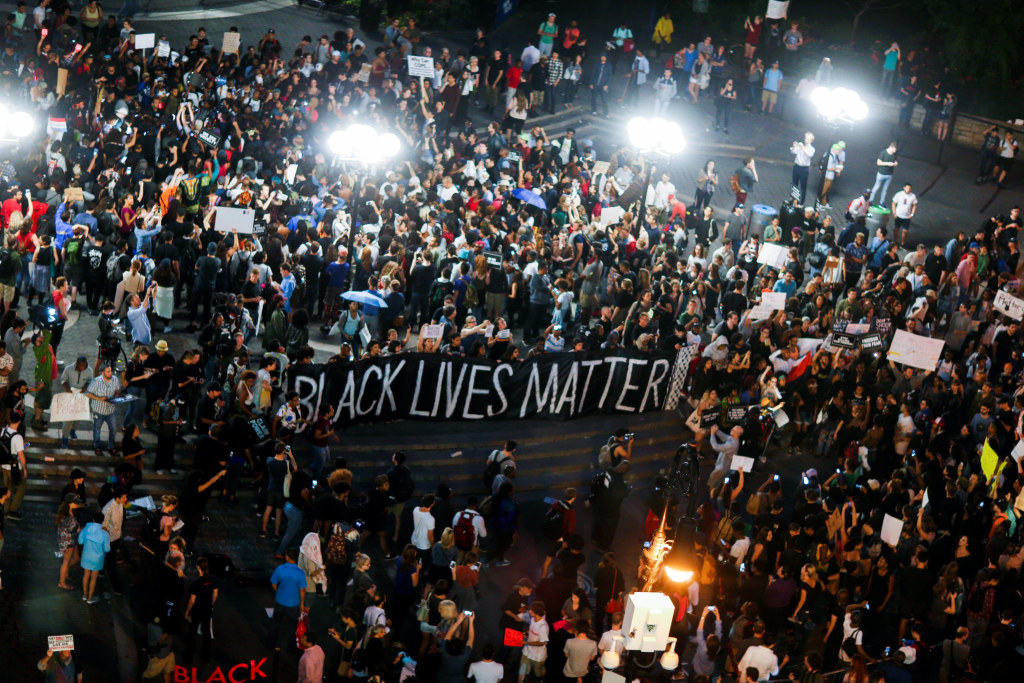 Image: People take part in a protest against police brutality and in support of Black Lives Matter during a march in New York