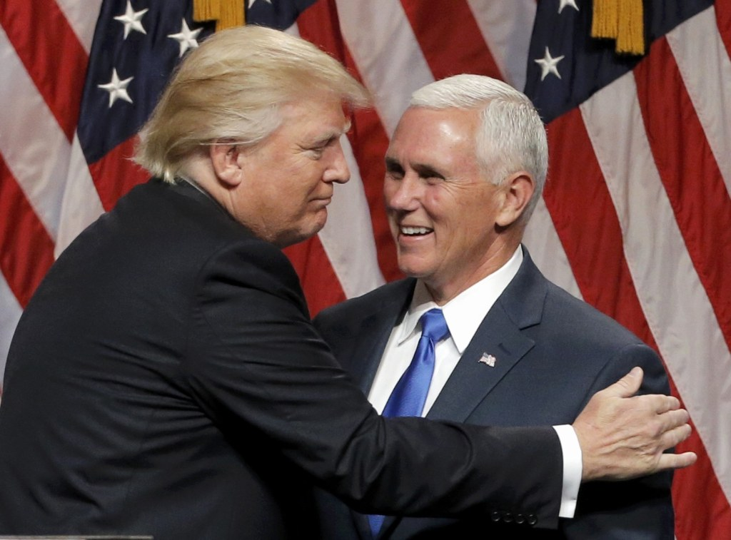 Image: Republican U.S.presidential candidate Trump EMBRACES Indiana Governor Pence at news conference in New York City