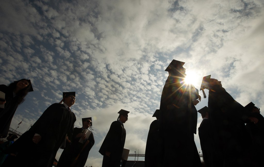 Graduating students arrive for Commencement Exercises at Boston College in Boston