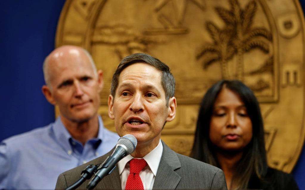 Image: Dr. Tom Frieden, Director of Centers for Disease Control and Prevention, speaks as Florida Gov. Rick Scott and Florida Surgeon General Celeste Philip look on during a press conference on the Zika virus in Doral