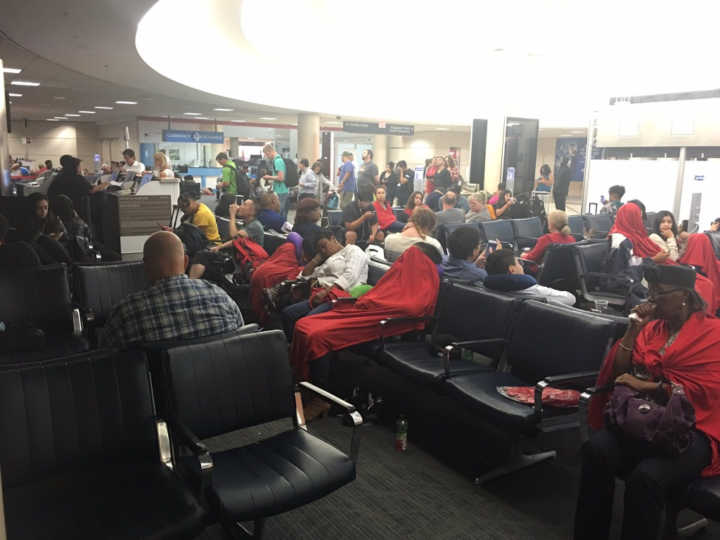 Image: At Los Angeles, passengers on late-evening redeye flights to the East Coast to were taken back to the terminal where they were still waiting for information at 3 a.m. PT.