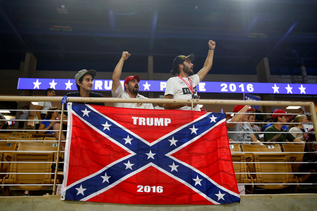 Image: Brandon Miles, Brandon Partin and Michael Miles cheer before Republican U.S. presidential nominee Donald Trump attends a campaign rally at the Silver Spurs Arena in Kissimmee, Florida