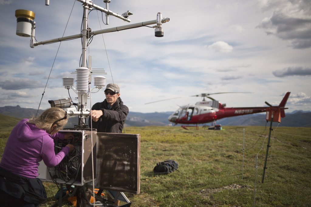 Image: Scientists perform an annual check at the Pamichtuk Lake climate monitoring station