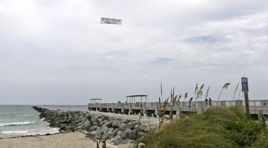 Image: An aerial banner is flown over the South Pointe Park pier