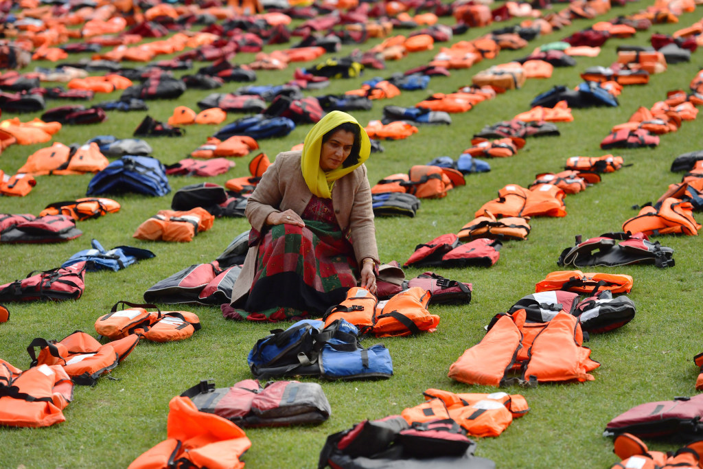 Image: Rahela Sidiqi, a trustee of Women for Refugee Women and originally from Afghanistan, views the life jackets