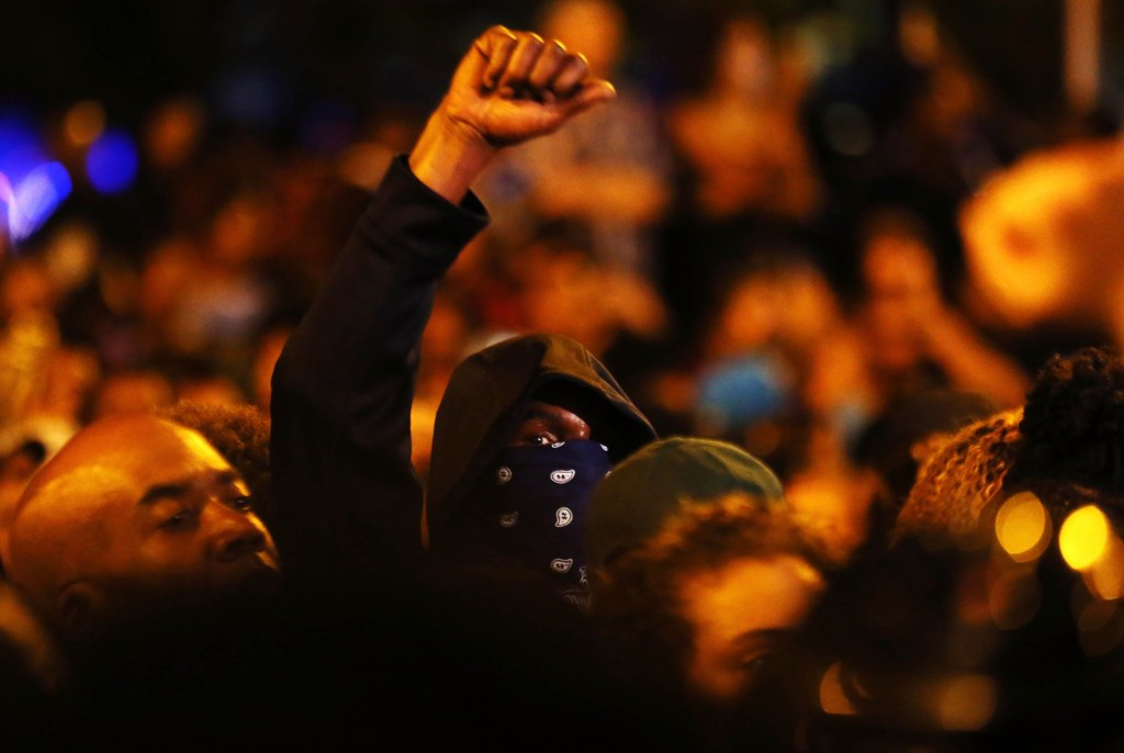 Image: Protesters rally during another night of protests over the police shooting of Keith Scott in Charlotte