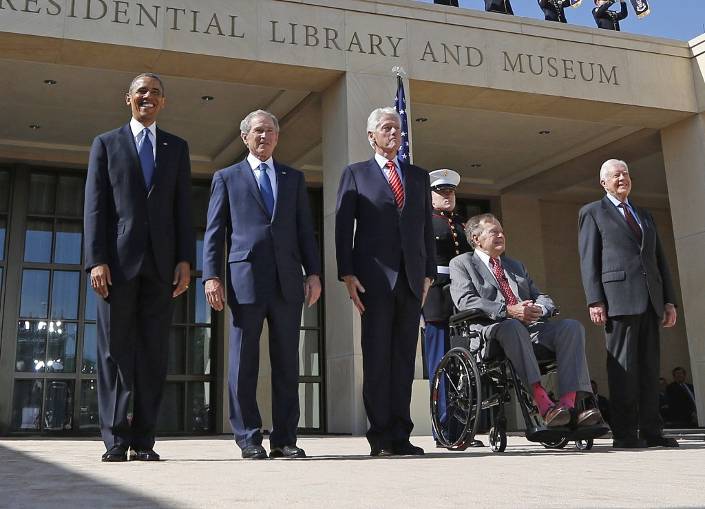 U.S. President Barack Obama stands alongside former presidents as they attend the dedication ceremony for the George W. Bush Presidential Center in Dallas