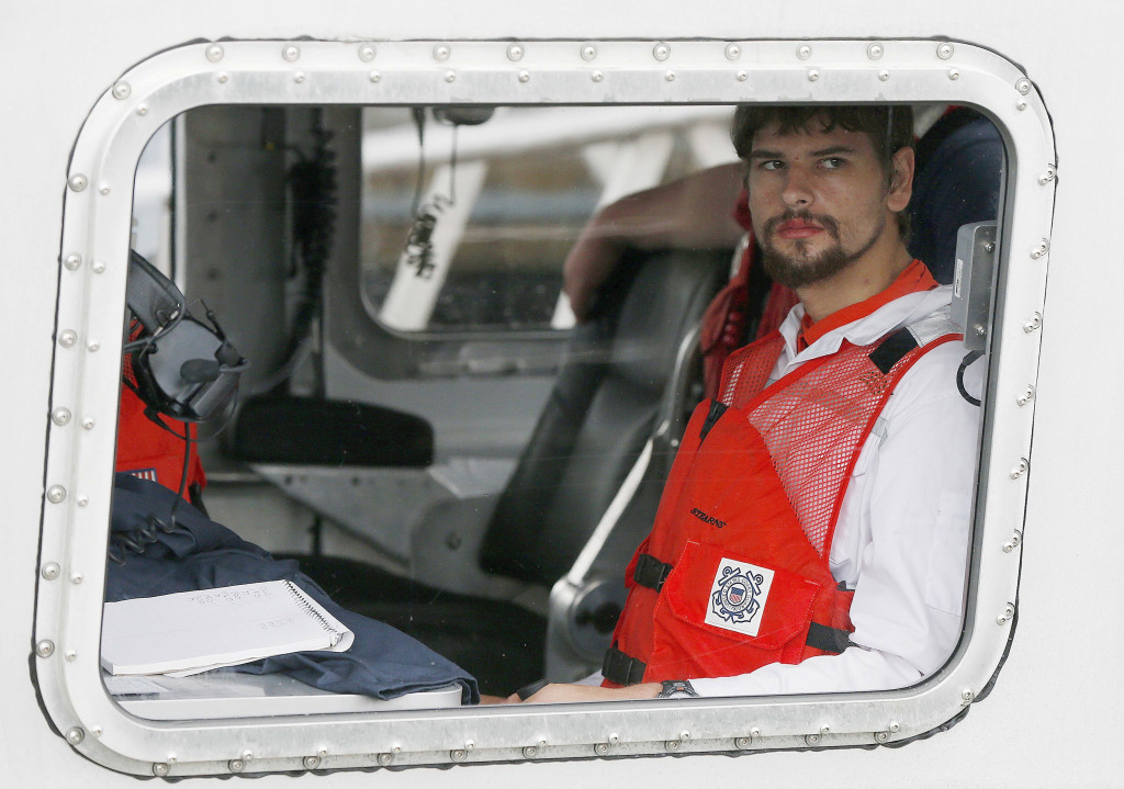 Image: Nathan Carman arrives in a small boat at the US Coast Guard station in Boston
