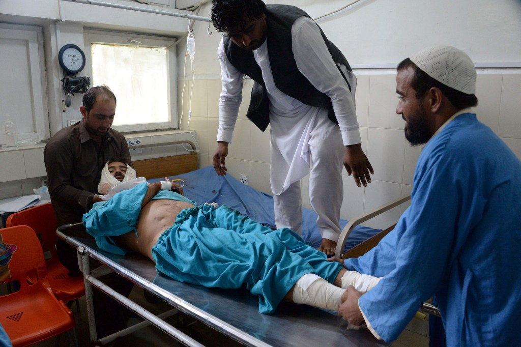 Image: An injured Afghan man receives treatment