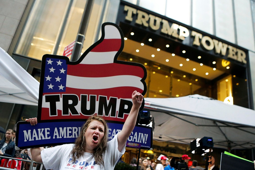 Image: Supporters of Republican presidential nominee Donald Trump stand outside Trump Tower where Trump lives, in the Manhattan borough of New York