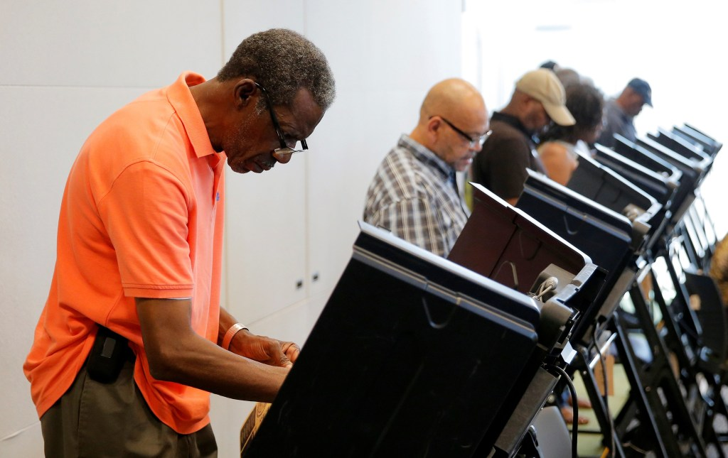 Image: Voters cast their ballots during early voting at the Beatties Ford Library in Charlotte, North Carolina