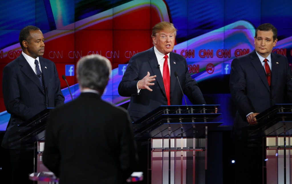 Image: Republican U.S. presidential candidate businessman Trump responds to a question from moderator Blitzer as Carson and Cruz look on during the Republican presidential debate in Las Vegas