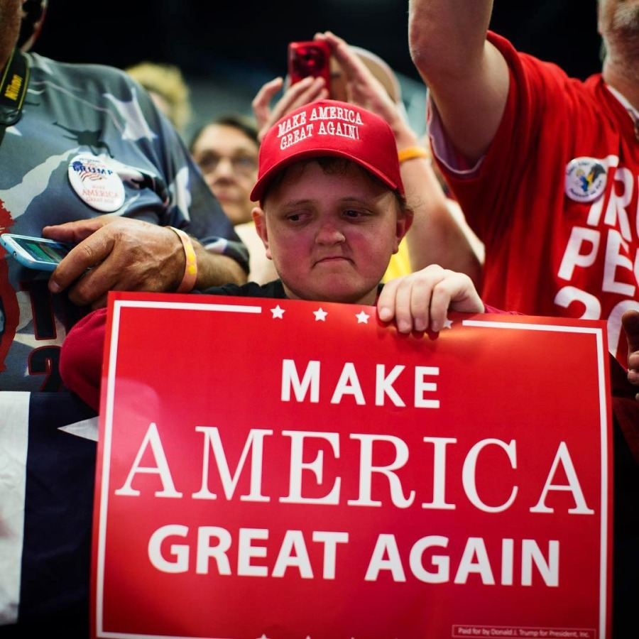 Image: Trump supporters listen as he speaks during a campaign rally in Eau Claire