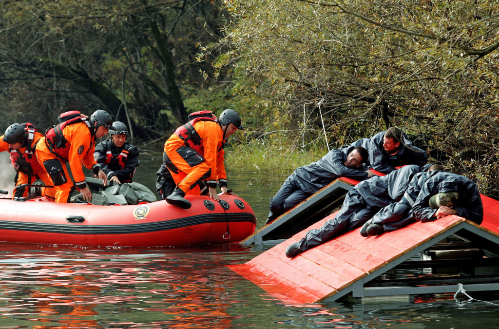Image: Rescue workers evacuate mock flood victims as part of an international field exercise in Podgorica