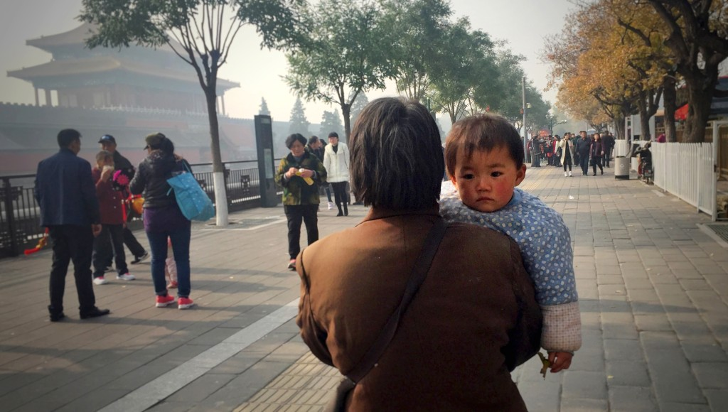 Image: A woman and baby in Bejing