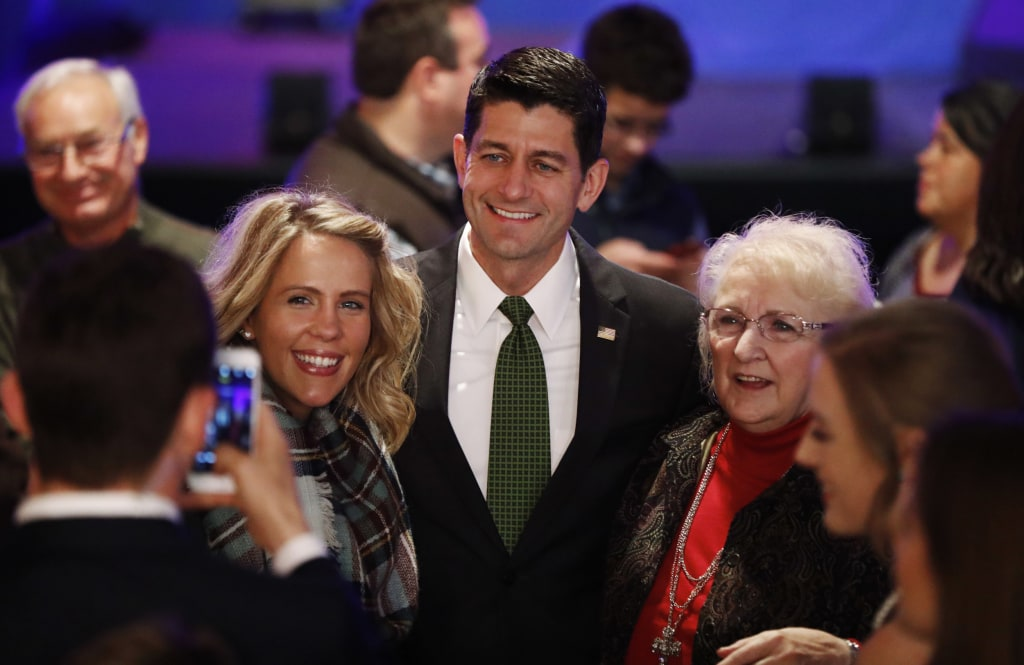Image: Paul Ryan poses for photos with supporters at a campaign rally