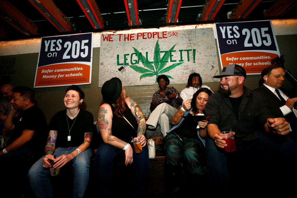 Image: People gather for an election watch party put on by supporters of a legal marijuana initiative in Phoenix, Arizona