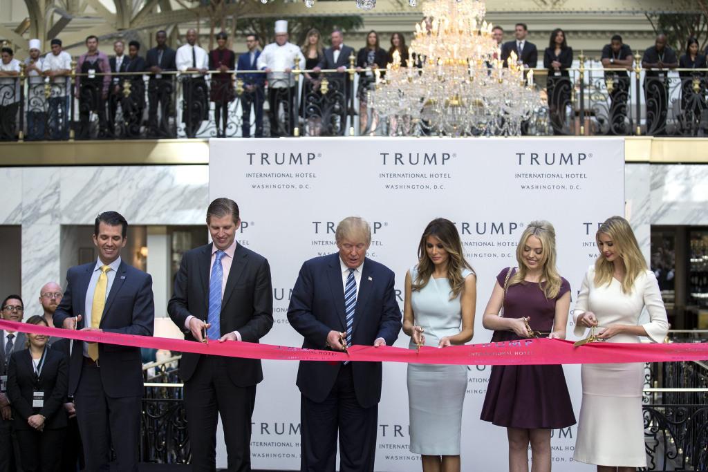 Image: Republican Presidential nominee Donald Trump participates in ribbon cutting ceremony for Trump International Hotel