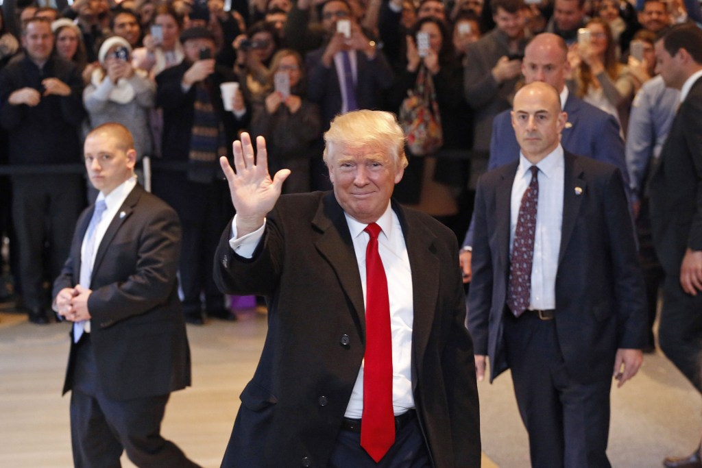 President Elect Donald Trump Waves To The Crowd As He Leaves New York Times Building Following A Meeting Tuesday Nov 22 2016 In