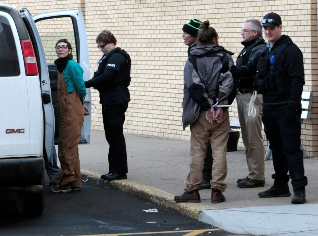 Image: A woman is taken into police custody outside an anti-Dakota Access Pipeline protest at Kirkwood Mall in Bismarck, North Dakota