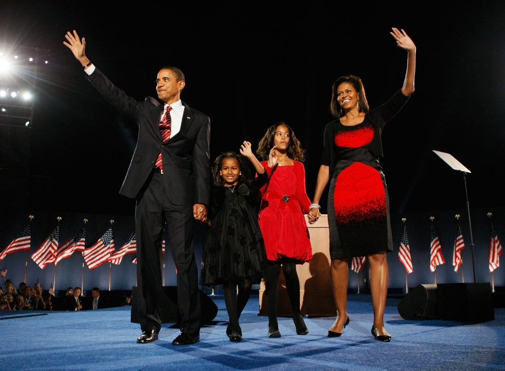 Image: President elect Barack Obama stands on stage along with his wife Michelle and daughters Malia (red dress) and Sasha  (black dress) during an election night gathering in Grant Park on Nov. 4, 2008 in Chicago, Ill.