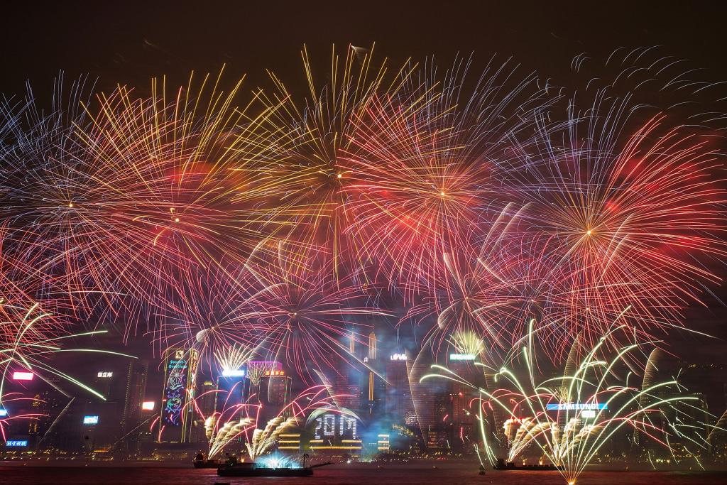 Image: Fireworks illuminate the city's skyline during New Year countdown celebrations