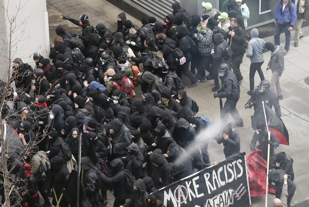 Image: Police use pepper spray on protesters in Washington, Jan. 20, 2017, in a chaotic confrontation blocks from Donald Trump's inauguration as protesters registered their rage against the new president.