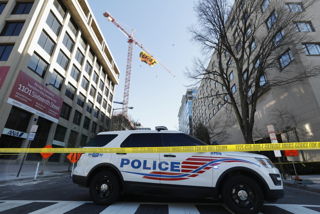 Image: A police car blocks the street near the construction site of the former Washington Post building in Washington, D.C., Jan. 25, 2017.