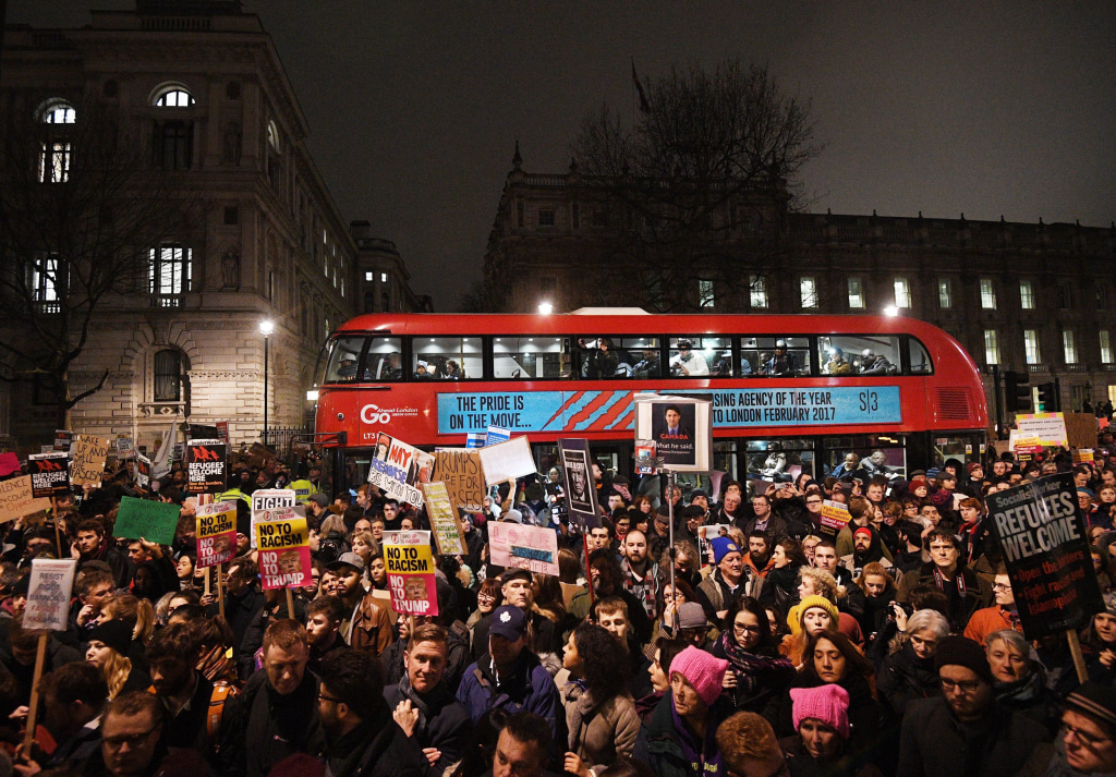 Image: Protesters hold banners during a protest outside 10 Downing Street in London