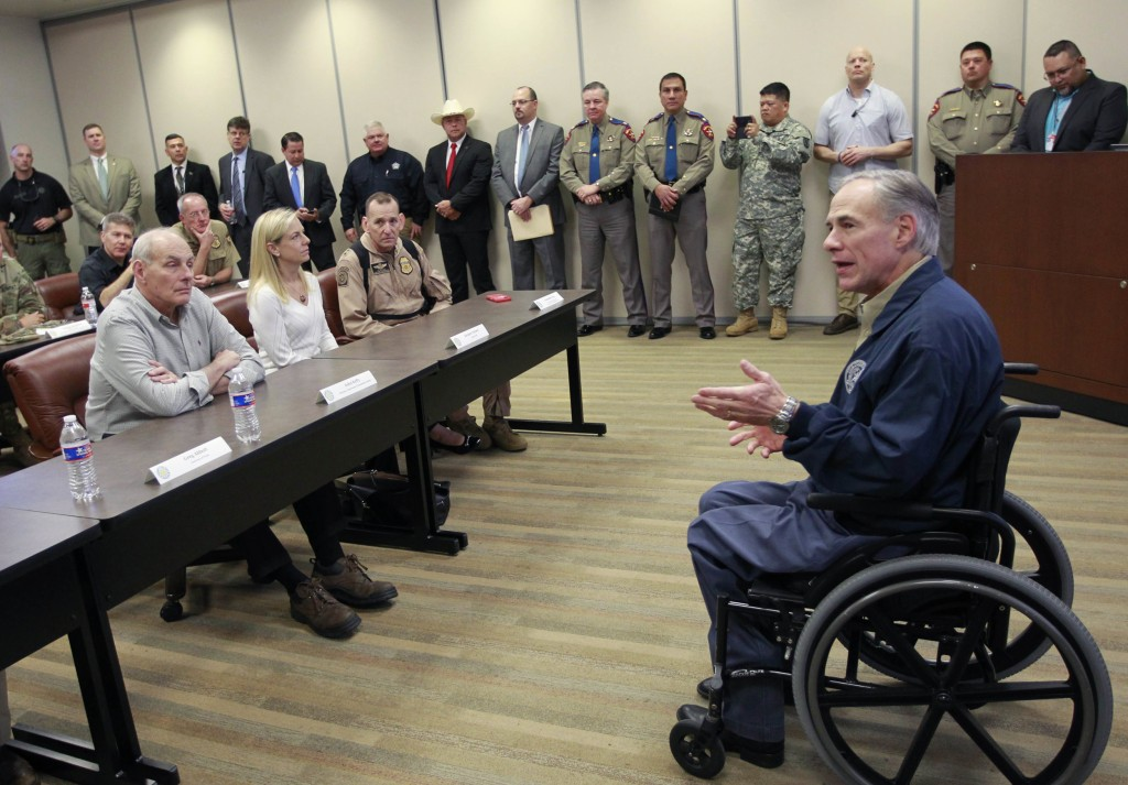 Image: Gov. Greg Abbott, right, talks with Secretary of Homeland Security John Kelly, left, before a briefing on border security on Feb. 1, 2017 at the Texas Department of Public Safety regional headquarters in Weslaco, Texas.