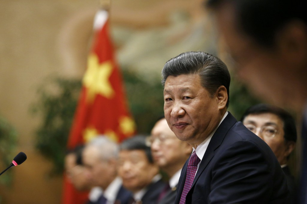 Image: Chinese President Xi Jinping attends a meeting at the United Nations European headquarters in Geneva