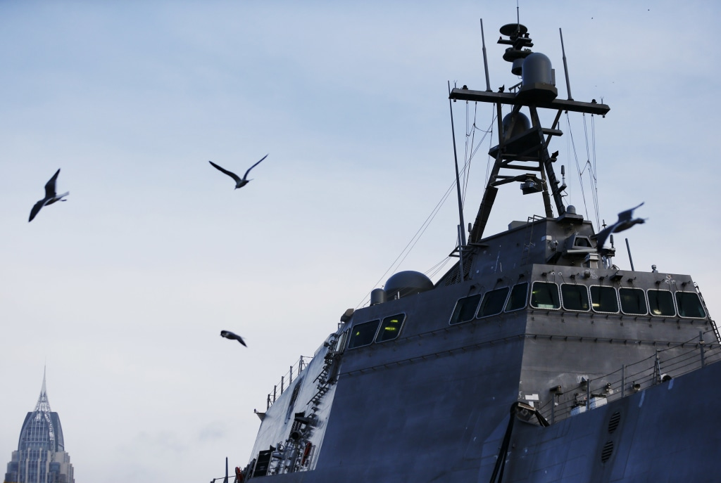 Image: Birds fly by a U.S. Naval littoral combat ship built docked on the Mobile River in Mobile, Ala., on Nov. 30, 2016.