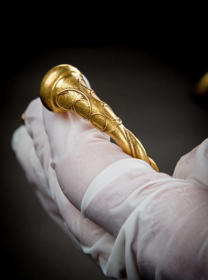 """Image: Details of an Iron Age gold """"torc"""" was on display on Tuesday."""