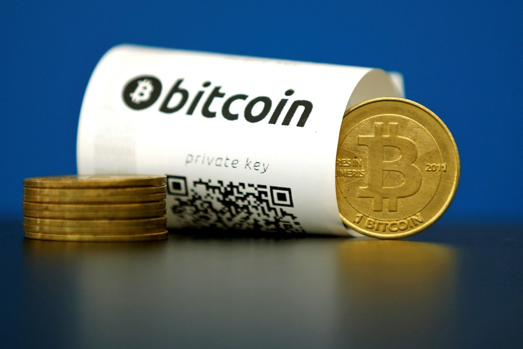 Image: An illustration photo shows a Bitcoin (virtual currency) paper wallet with QR codes and a coin