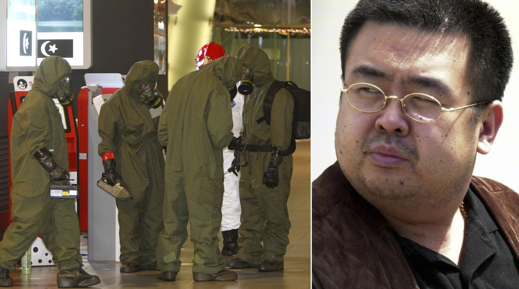 Image: Hazmat crews gather at the main hall of Kuala Lumpur airport