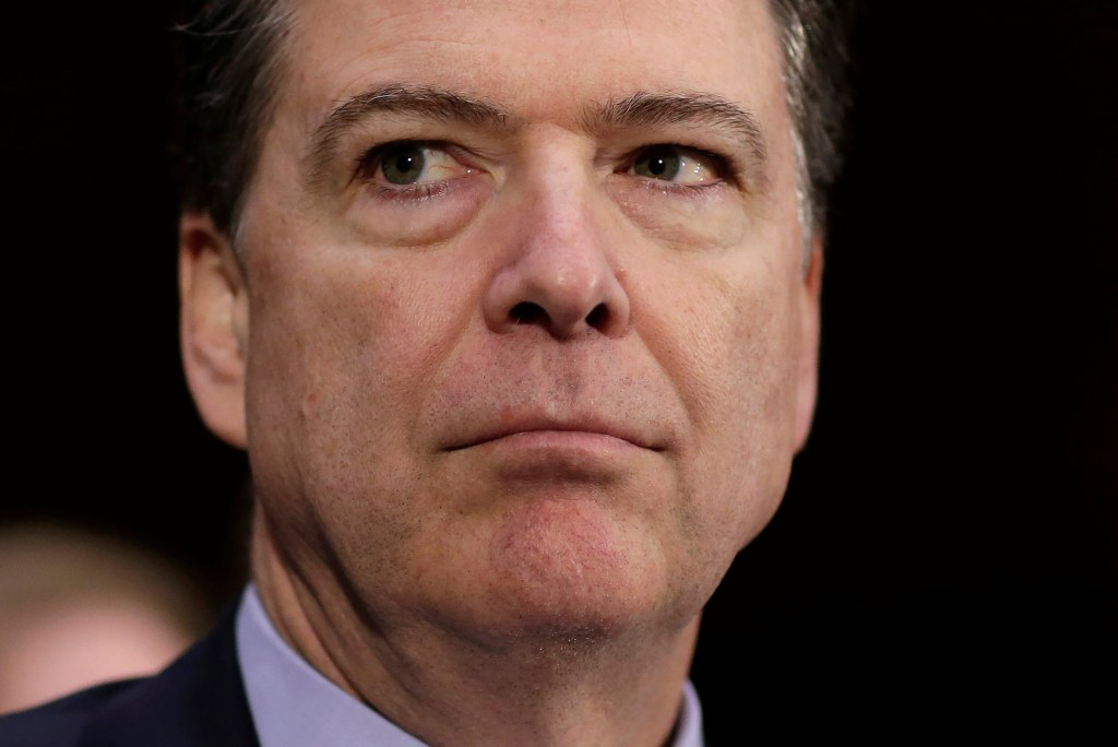 """Image: FBI Director James Comey waits to testify to the Senate Select Committee on Intelligence hearing on """"Russia?EUR(TM)s intelligence activities"""" on Capitol Hill in Washington"""