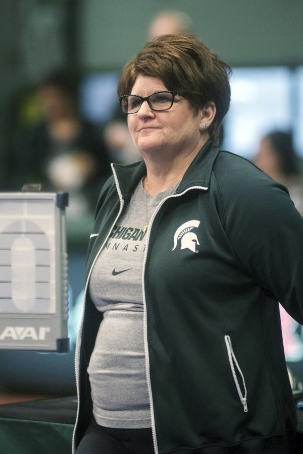 Image: Michigan State University gymnastics head coach Kathie Klages watches the team during a meet in East Lansing, Mich. in February 2015