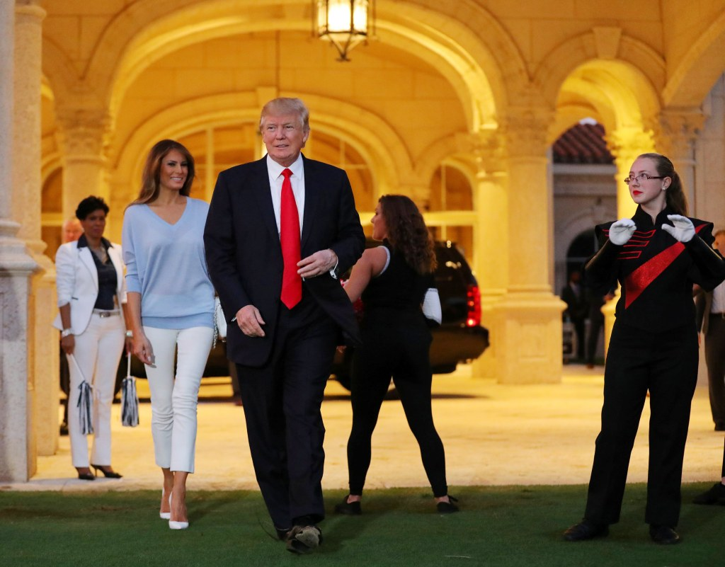 Image: Trump and First Lady Melania Trump greet a marching band as they arrive at Trump International Golf club to watch the Super Bowl LI between New England Patriots and Atlanta Falcons in West Palm Beach, Florida, U.S.