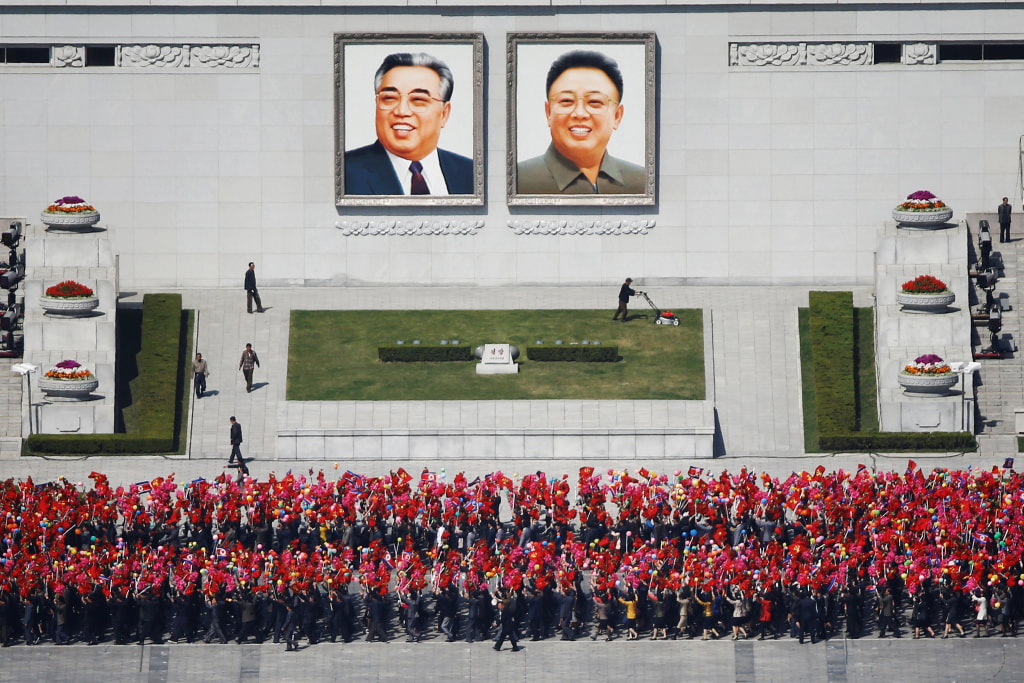 Image: People practice for the expected parade on the main Kim Il-Sung Square in central Pyongyang